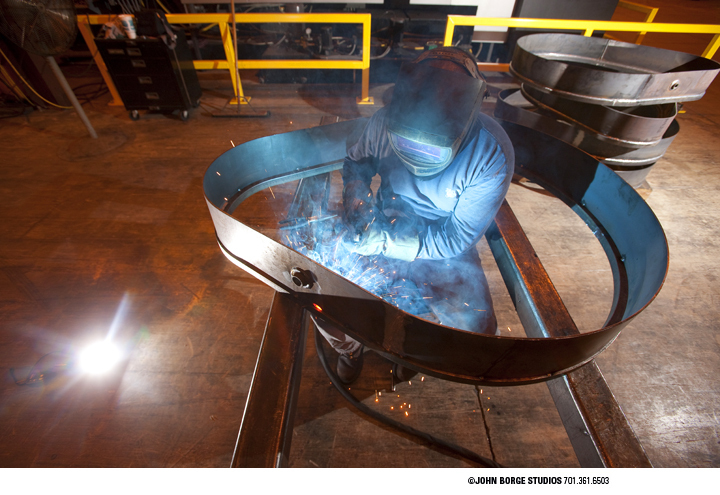 Positioned a single flash on the floor to give the industrial welding image some added spark : industrial : JOHN BORGE STUDIOS Fargo North Dakota Photography Advertising, Public Relations