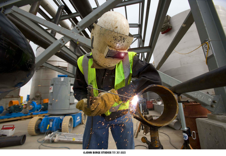 Welding on-site in North Dakota : industrial : JOHN BORGE STUDIOS Fargo North Dakota Photography Advertising, Public Relations
