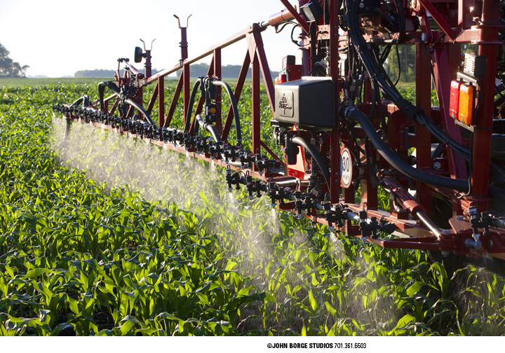 Spraying in early light - a project for an implement manufacturer : agriculture : JOHN BORGE STUDIOS Fargo North Dakota Photography Advertising, Public Relations