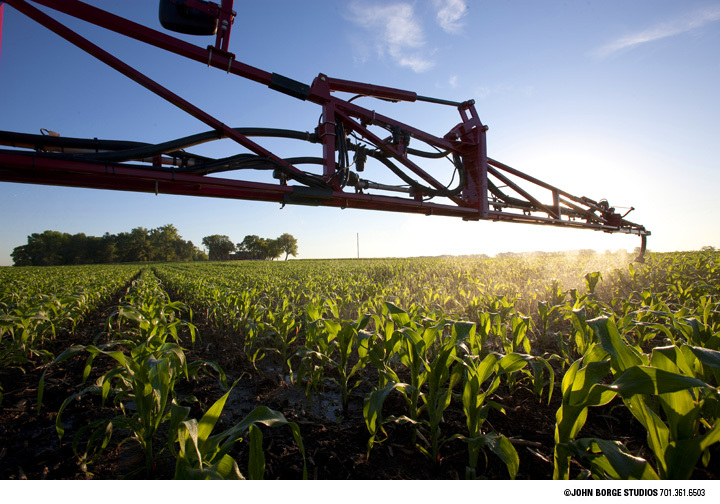 Spraying in the morning light in South Dakota : agriculture : JOHN BORGE STUDIOS Fargo North Dakota Photography Advertising, Public Relations