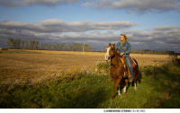 Riding horseback near Jamestown, North Dakota